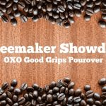 """An image reading """"Coffeemaker Showdown: OXO Good Grips Pourover"""". The image is lined with coffee beans on a wood background."""