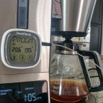 A digital thermometer is attached to the coffeemaker. It shows a temperature of 195 degrees.