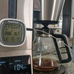 A digital thermometer is attached to the coffeemaker. It shows a temperature of 167 degrees.