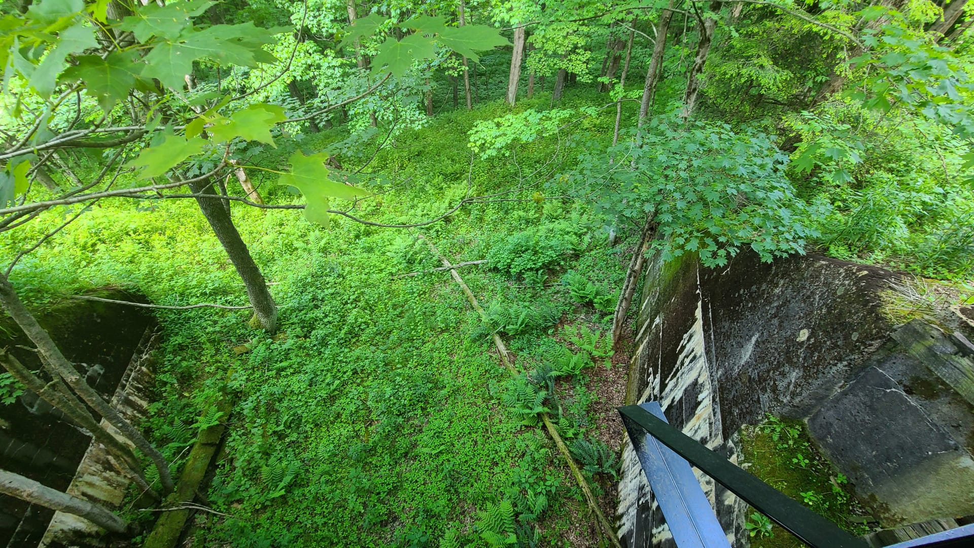 Looking down from a bridge, showing signs of an old road