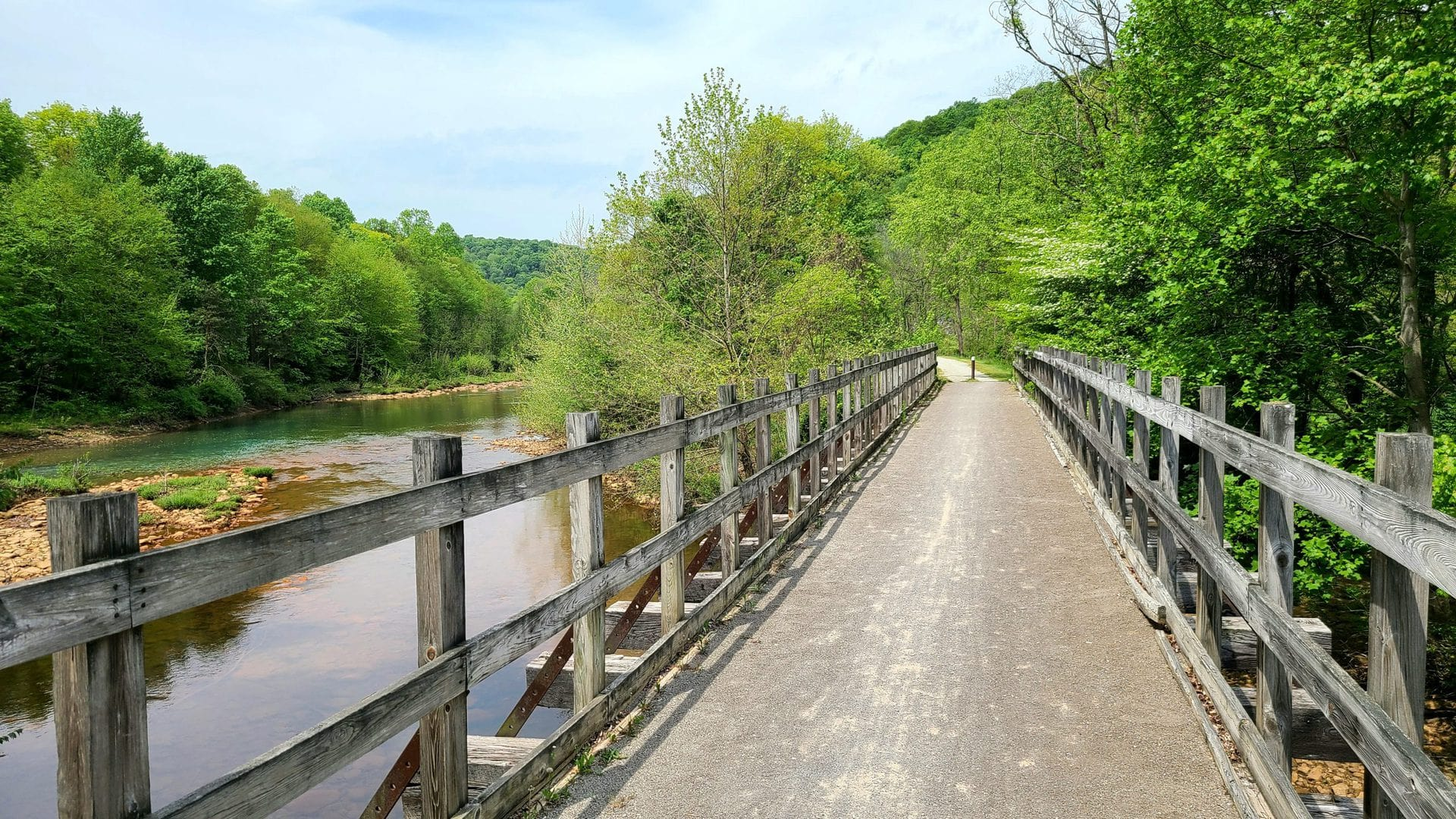 A wooden bridge overlooking Blacklick creek. The trail continues into the distance.