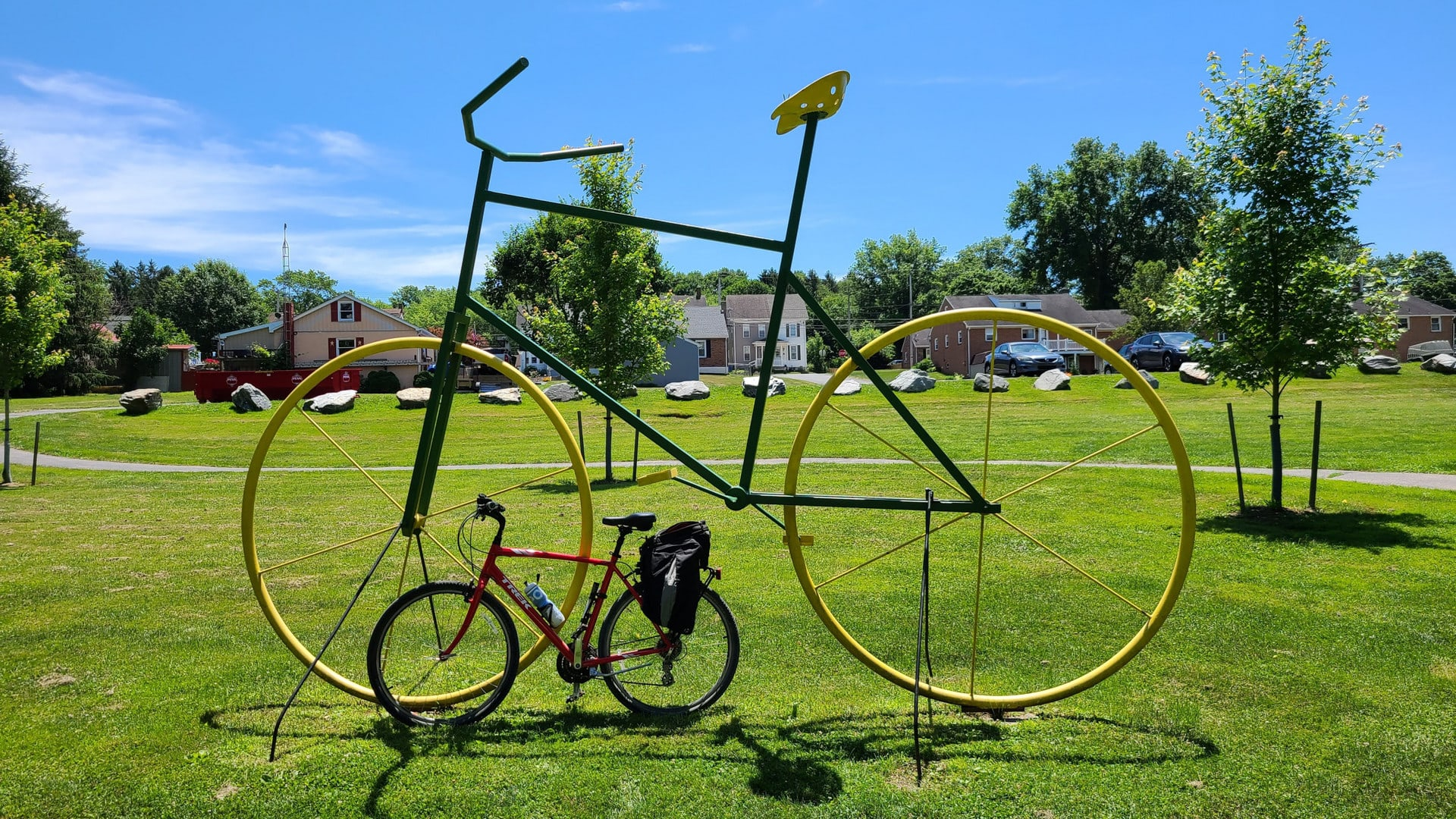 A bike statue made of metal pipe stands approximately 15 feet tall. My red Trek bike is parked in front of the statue for scale.