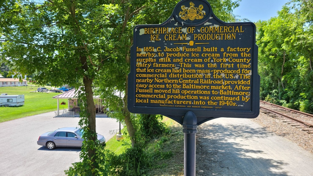 A Pennsylvania historic marker describes how C Jacob Fussell created the first factory to mass-produce ice cream.